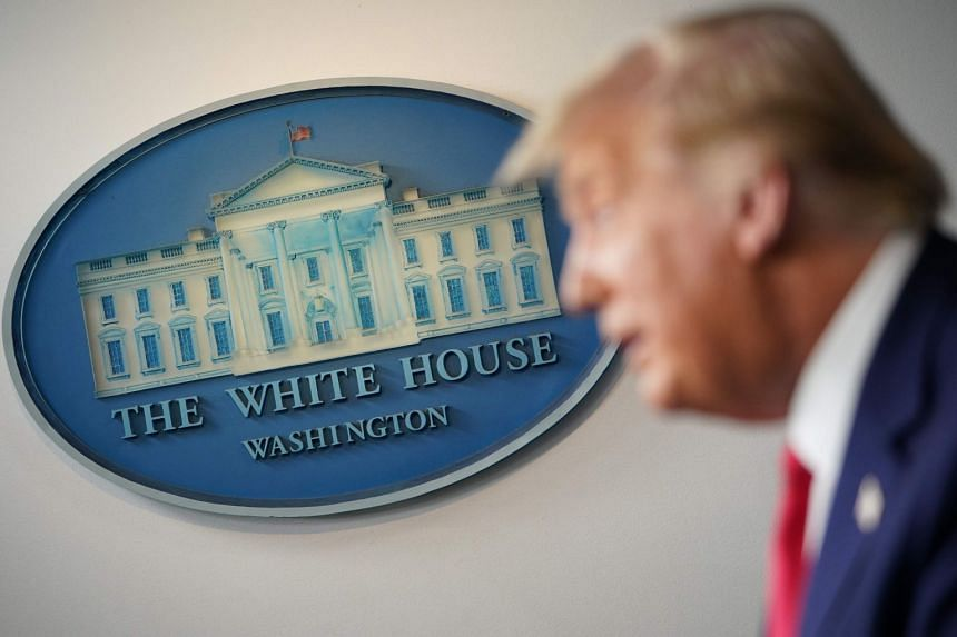 The White House seal is seen as US President Donald Trump speaks during a press conference.