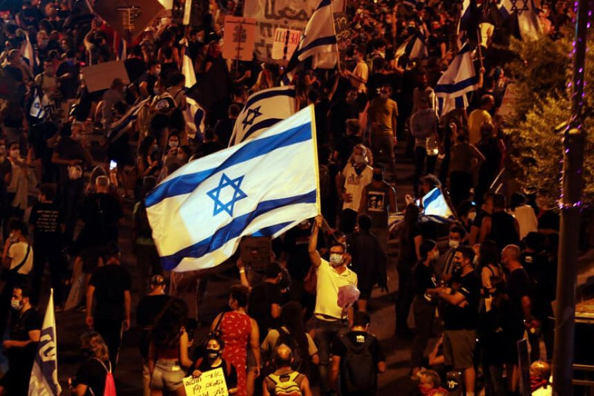 People protest amid a second nationwide lockdown in Jerusalem, on Sept 20, 2020.