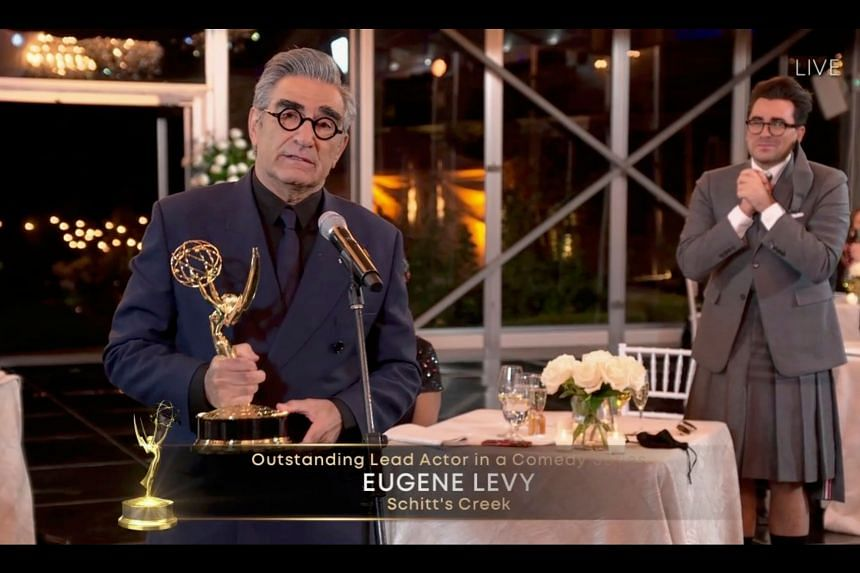 Canadian actor Eugene Levy speaks after receiving his Emmy while his son Daniel Levy watches during the 72nd Primetime Emmy Awards ceremony held virtually on Sept 20, 2020.