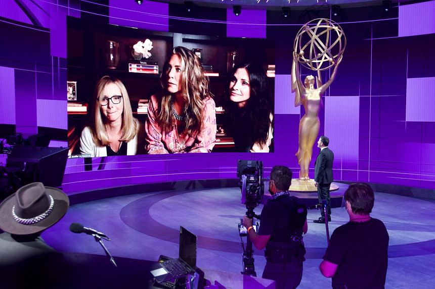 Jimmy Kimmel in front of a screen showing nominee Jennifer Aniston watching remotely with her friends Lisa Kudrow and Courteney Cox at the Staples Center during the 72nd Primetime Emmy Awards ceremony held virtually on Sept 20, 2020.