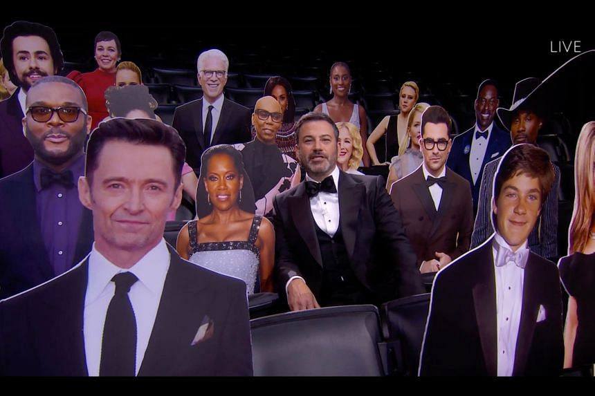 Jimmy Kimmel sitting among celebrities carbord cutouts during the 72nd Primetime Emmy Awards ceremony held virtually on Sept 20, 2020.