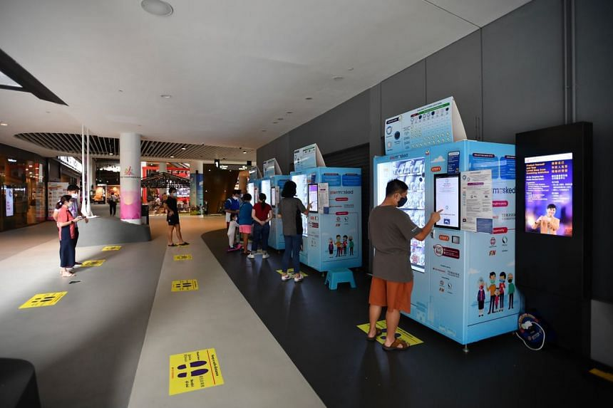 People collecting their free mask kits at Our Tampines Hub on Sept 21, 2020.