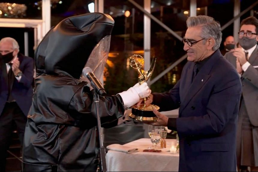 Canadian actor Eugene Levy receives his Emmy during the 72nd Primetime Emmy Awards ceremony held virtually on Sept 20, 2020.