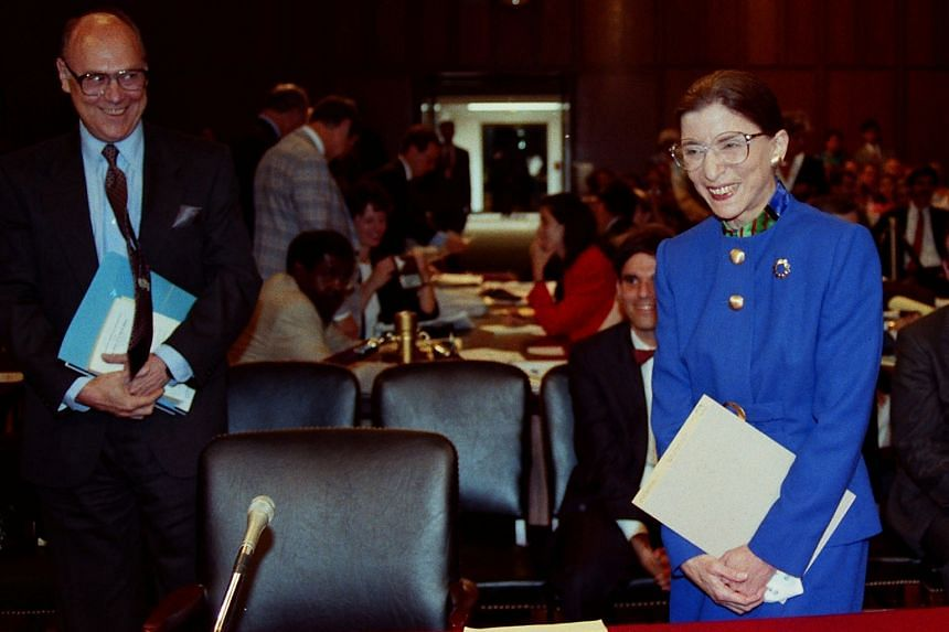 A July 20, 1993, file photo of then Supreme Court nominee judge Ruth Bader Ginsburg and her husband Martin at her confirmation hearing before the Senate Judiciary Committee on Capitol Hill in Washington.