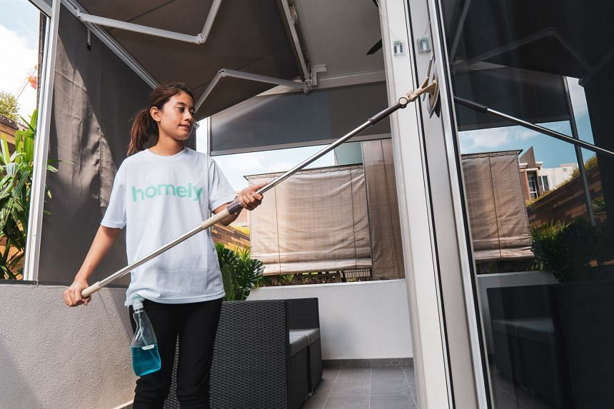 An employee of A1 Facility Services cleaning a house. The company employs between 100 and 200 staff, but is still facing a manpower shortage, with more people wanting more disinfection services. PHOTO: A1 FACILITY SERVICES