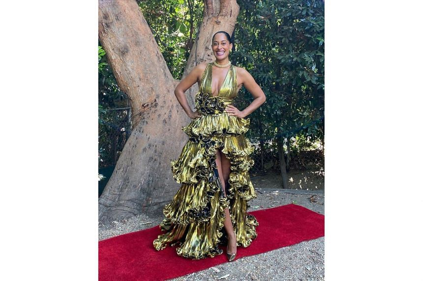 Tracee Ellis Ross made waves on her own red carpet at home (above) – in a plunging chartreuse gold number from Alexandre Vauthier, Jimmy Choo heels and vintage Tiffany jewellery.