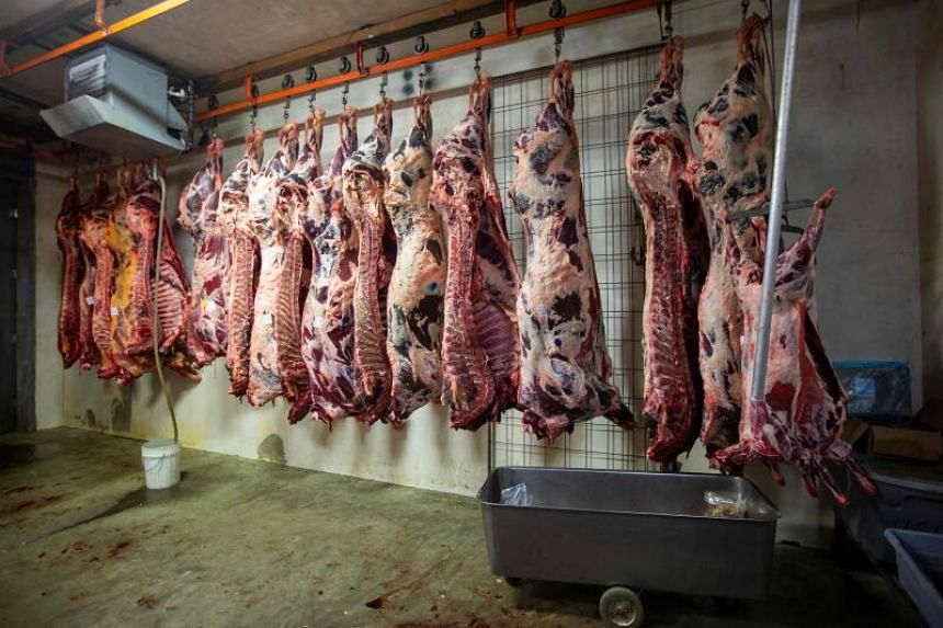 The United States has yet to impose any mandatory safety measures on meatpackers to contain infections.