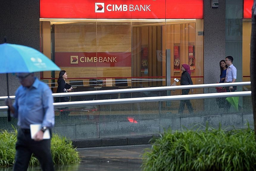 DBS (top) says it will collaborate with the authorities to seize funds and disrupt criminal networks, while CIMB (above) says it operates in compliance with the anti-money laundering laws issued by the Monetary Authority of Singapore.