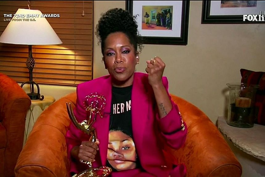 Regina King  made a powerful statement – not just with her fuchsia pantsuit, but the T-shirt she paired it with, which depicted Ms Breonna Taylor, who was fatally shot in a botched police raid.