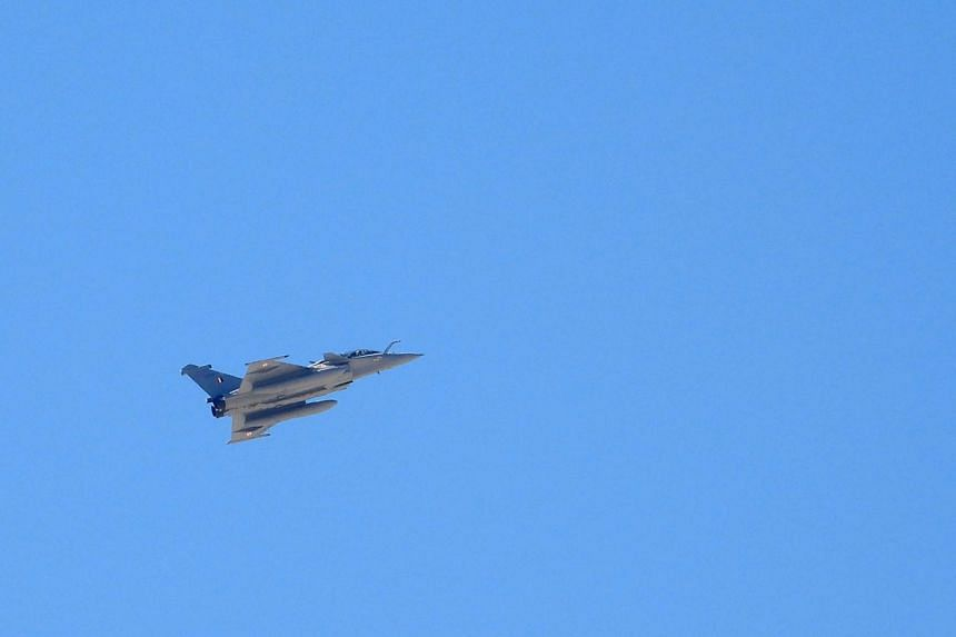 An Indian Air Force Rafale jet flies over Leh, on Sept 21, 2020.
