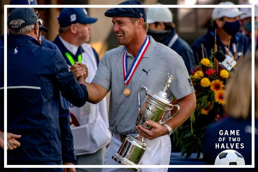 Bryson DeChambeau holds up the winner's trophy after winning the U.S. Open at Winged Foot Golf Club in Mamaroneck, N.Y., Sunday, Sept. 20, 2020.