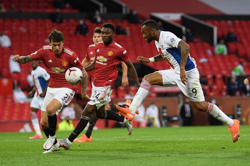 Crystal Palace's Jordan Ayew (right) shoots and the ball touches the hand of Manchester United's Victor Lindelof to concede a penalty on Sept 19, 2020.