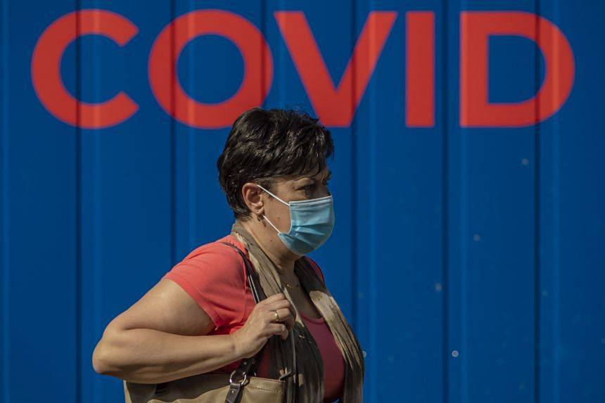 A woman walks by a coronavirus testing station in Prague on Sept 21, 2020.
