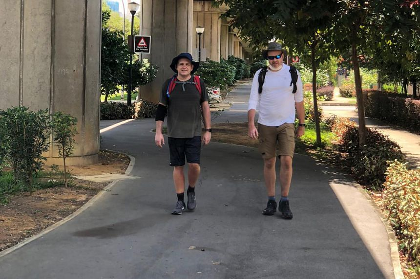 From left: Mr Simon Hamer and Mr Oliver Wingrove during their 58km walk from Raffles Marina in Tuas to Changi Beach last Saturday, in preparation for their longer trek with two others on Sept 30.