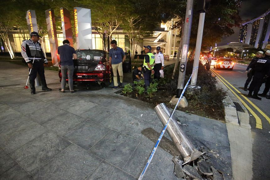 Three female pedestrians were injured when a car (left) driven by Lim Wei Sheng crashed into them near Marina Bay Financial Centre on April 15 last year. PHOTOS: LIANHE ZAOBAO FILE, KELVIN CHNG