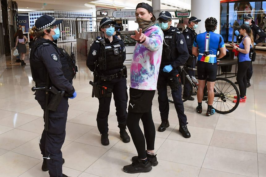 Police stopping people in a Melbourne mall for checks following an anti-lockdown protest on Sunday. Australia reported 16 new coronavirus infections yesterday, its smallest daily increase in cases since mid-June. The bulk of the new cases once again