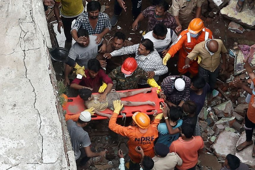 Thirteen people were killed and up to 25 are feared trapped after a three-storey residential building collapsed before dawn yesterday in the city of Bhiwandi in western India, officials said. Emergency workers from the National Disaster Response Forc