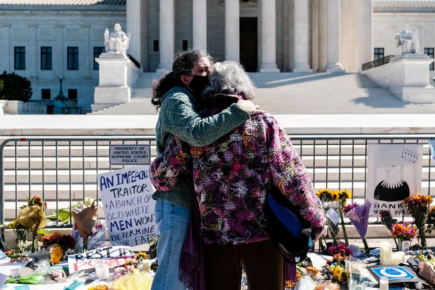 Above: A makeshift memorial for Supreme Court Justice Ruth Bader Ginsburg at the Supreme Court building in Washington on Sunday. Right: A vigil for Justice Ginsburg in Monument Square in Portland, Maine, on Sunday. President Donald Trump is determine