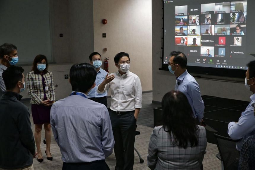 Education Minister Lawrence Wong (centre) said about 18,000 of the 30,000 places have been created to date by employers like IBM.