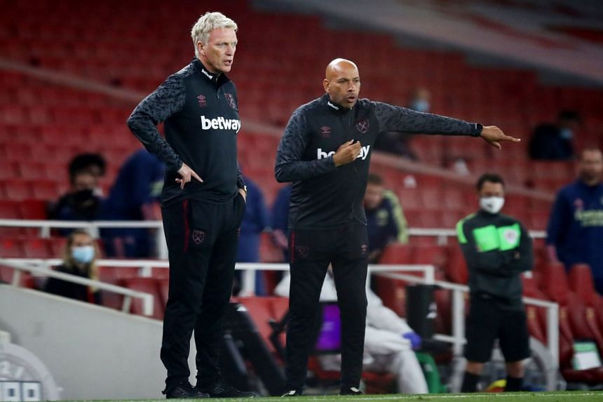 Moyes (left) and  coach Paul Nevin during West Ham's Premier League match against Arsenal on Sept 19, 2020.