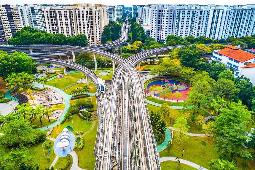 """Mr Soh Eng Kien took this photo of the Sengkang Sculpture Park near Sengkang MRT station using a drone. He says: """"My actual intention was to capture the intertwining LRT tracks from directly above them and I didn't notice the park below or the HDB bl"""