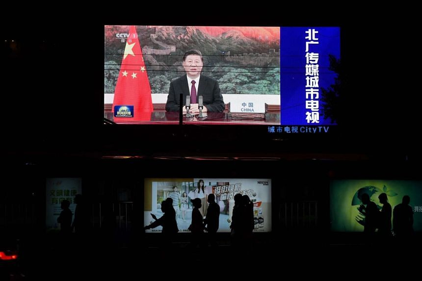 A screen in Beijing shows China's Xi Jinping appearing by video link at the United Nations on Sept 22, 2020.