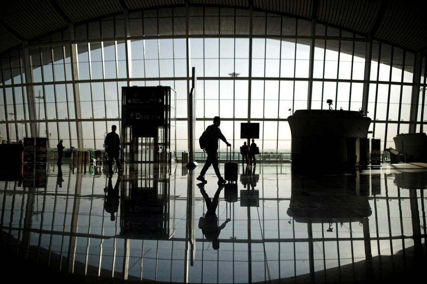 Travellers at the Beijing Daxing International Airport, in Beijing on Sept 19, 2020.