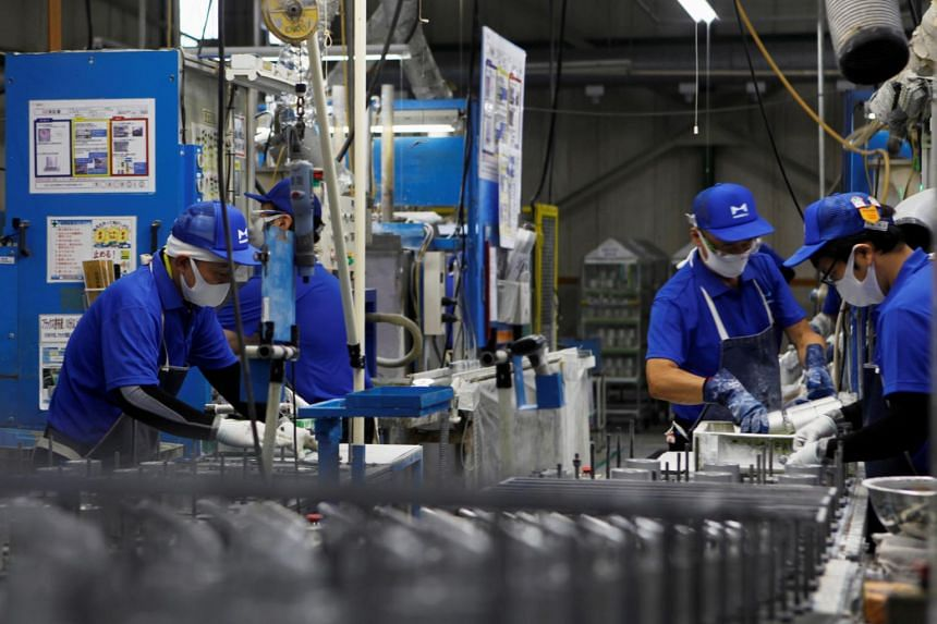 Workers along the assembly line at Marelli's factory in Ora Town, Japan, on July 30, 2020.