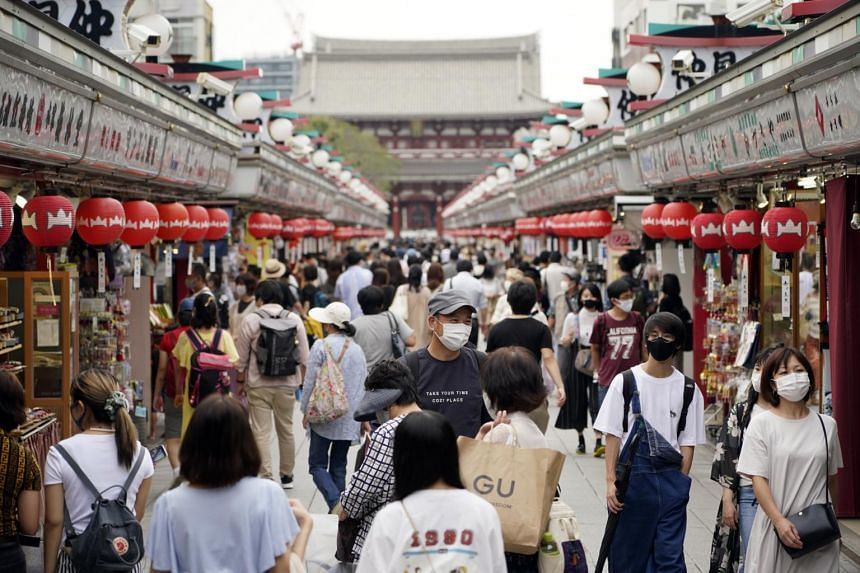 Visitors walk through the Nakamise shopping street in Tokyo on Sept 13, 2020.