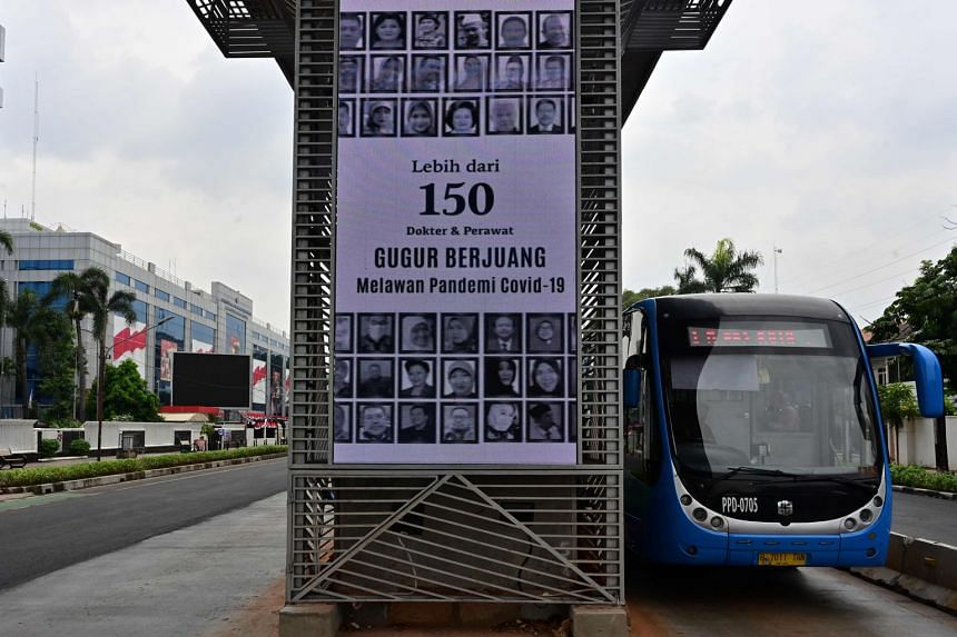 Portraits of doctors and nurses who have died from Covid-19 displayed as part of a public awareness campaign about the virus in Jakarta. Earlier this month, Indonesia's Covid-19 spokesman said the city's 67 Covid-19 referral hospitals had an occupanc