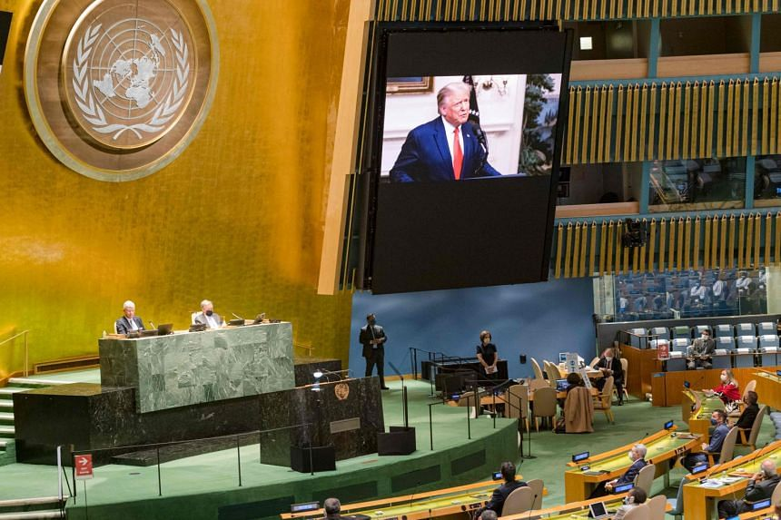Trump (on screen) addresses the UN General Assembly.