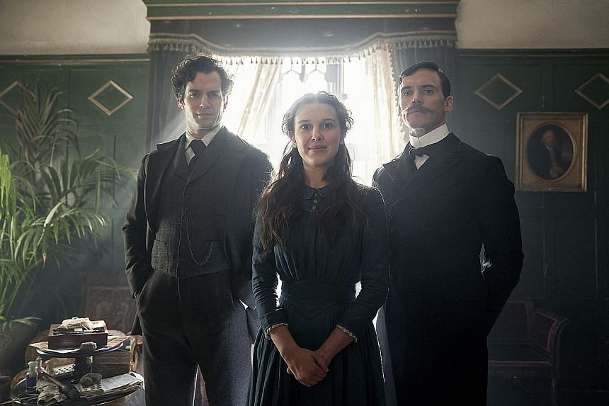 English actress Millie Bobby Brown is Enola Holmes in a new Netflix movie adapted from the young-adult book series written by Nancy Springer. Sam Claflin (left) and Henry Cavill (far left) play her older brothers Mycroft and Sherlock.
