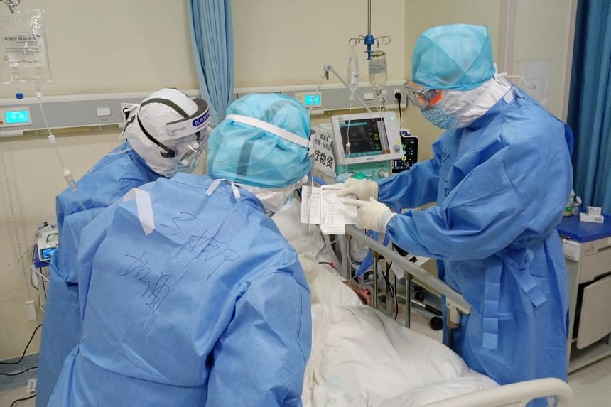 Dr Liu Zhuang's team at work at the Wuhan Union Hospital in February.