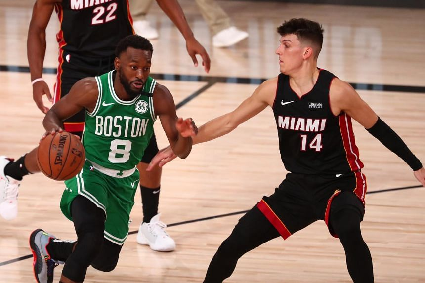 Tyler Herro of the Miami Heat (right) made 14 of 21 shots off the bench during the game against the Boston Celtics.