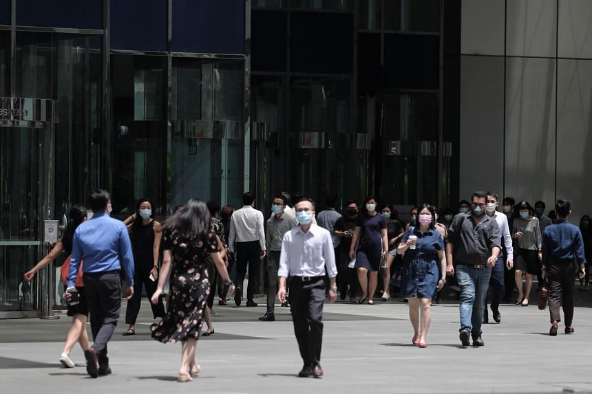 Office workers are seen at Raffles Place on Sept 8, 2020.