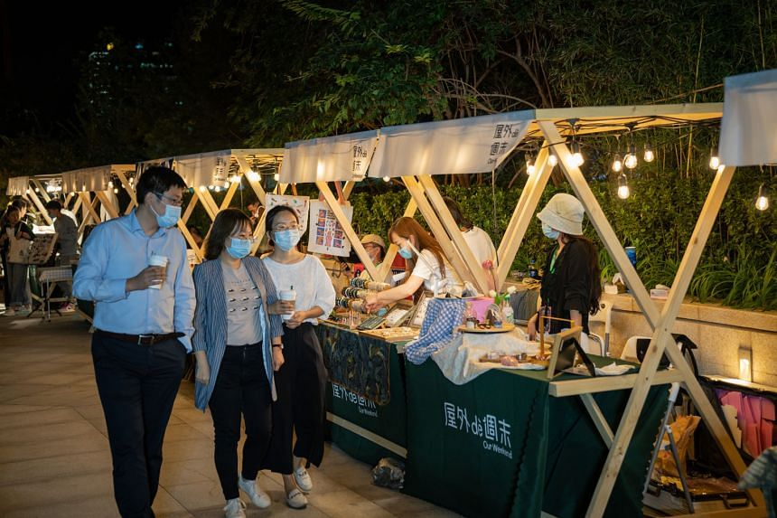 "People at a night market in Beijing last Friday. Asia's economic rebound would be ""strongly linked"" to the recovery in the Chinese economy, says Mr Satish Shankar, the Asia-Pacific managing partner of business consultancy Bain & Company. China expand"
