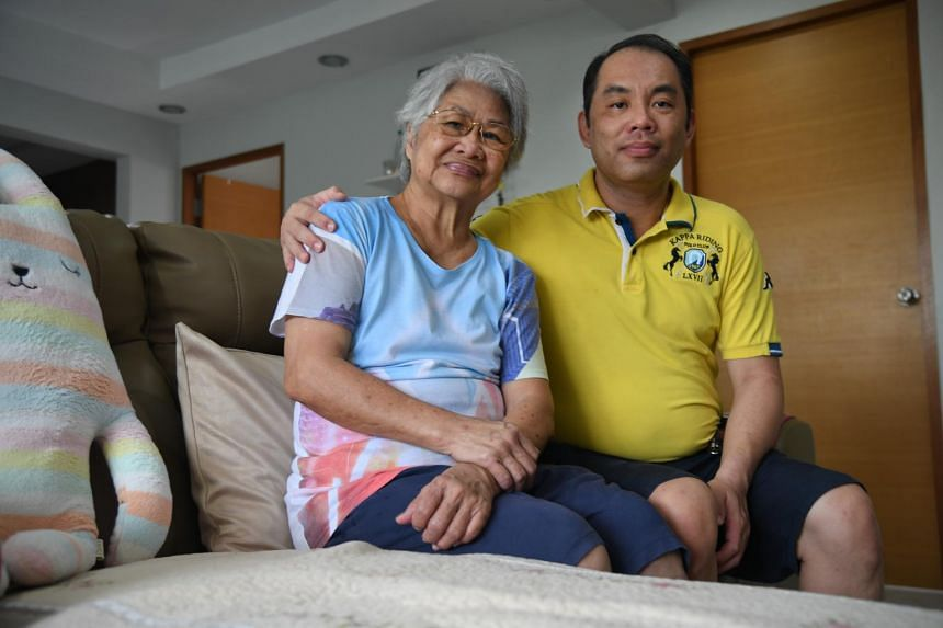 Madam Ng Chong Poy, who has dementia, with her eldest son, Mr Raymond Shong.