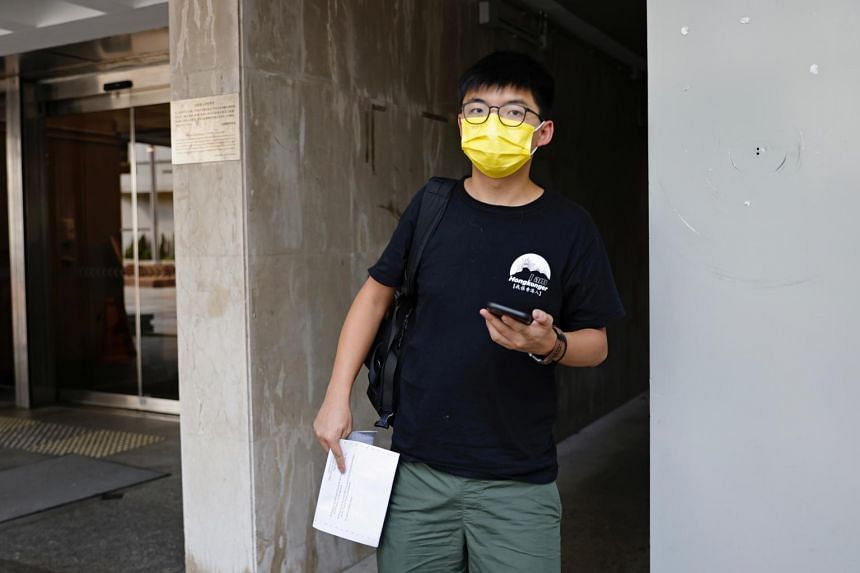 """Joshua Wong was arrested for """"unlawful assembly"""" related to a 2019 protest against a government ban on face masks."""
