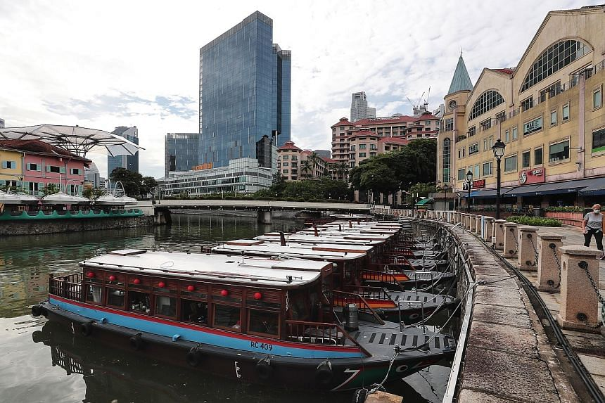 Empty tourist boats docked along the Singapore River in Clarke Quay last month. Tourism industry leaders at the roundtable session spoke about the challenges they face amid the tourist drought and safe distancing curbs.