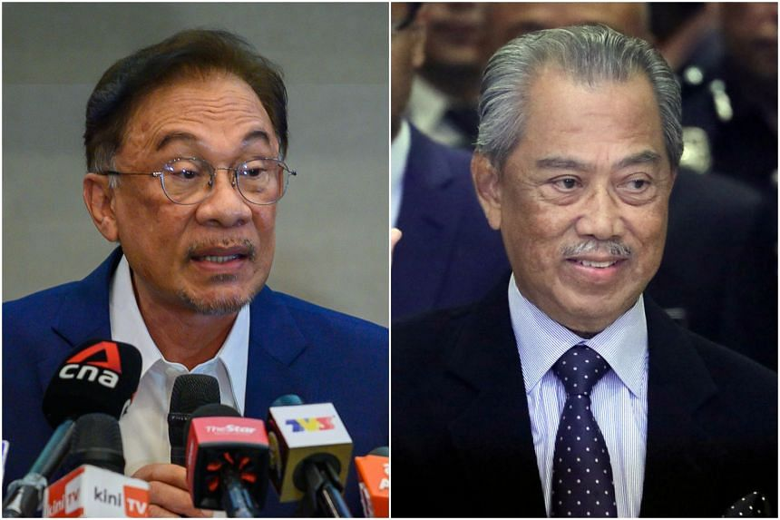 Umno MPs are claimed to have shifted support to PKR president Anwar Ibrahim (left) from Prime Minister Muhyiddin Yassin.