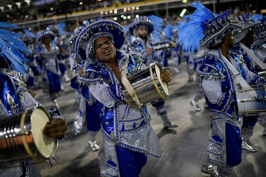 Brazil's top 13 samba schools normally parade through the Sambadrome before up to 90,000 people celebrating Carnival.