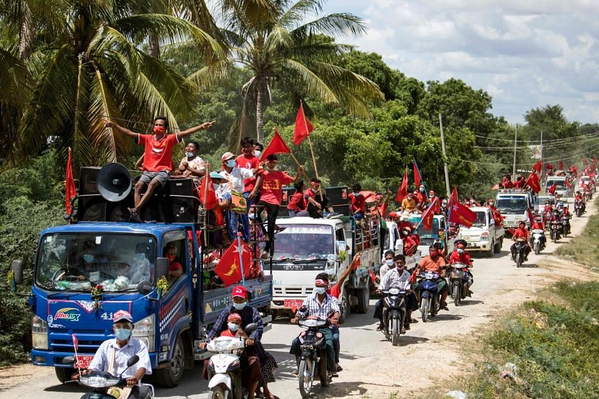 Supporters of the National League for Democracy ride a motorcade during a campaign in Wundwin, Myanmar, on Sept 17, 2020.