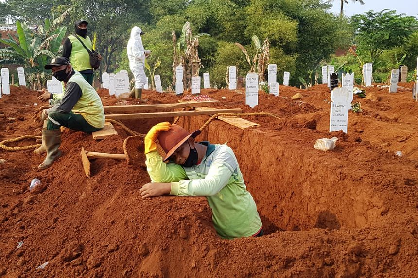 Indonesian gravedigger Adang Saputra at Pondok Ranggon public cemetery in East Jakarta.