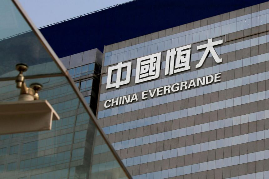 """Evergrande said in a statement that online social media posts about its asset restructuring plans are """"made up"""" without specifying details."""