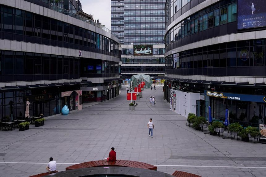 People walk at a shopping mall in Shanghai on Sept 22, 2020.