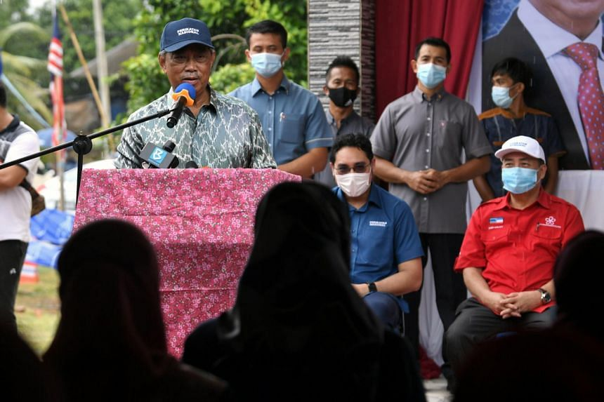 Malaysian PM Muhyiddin Yassin speaking at a meet-the-people session at Kampung Sungai Damit, Sabah, on Sept 25, 2020.