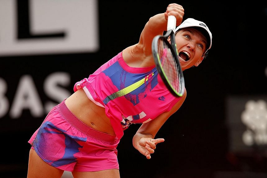 Romania's Simona Halep serving up another dominant performance on clay during the Italian Open final against Karolina Pliskova. Her victory extended her winning streak to 14 matches.