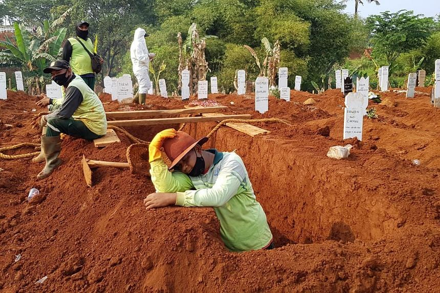 Above: Mr Adang Saputra, a gravedigger at Pondok Ranggon cemetery in East Jakarta, gets up at the crack of dawn to get to work, rotating shifts among other workers to bury the dead till as late as 10pm. Top and right: Family members of Covid-19 victi