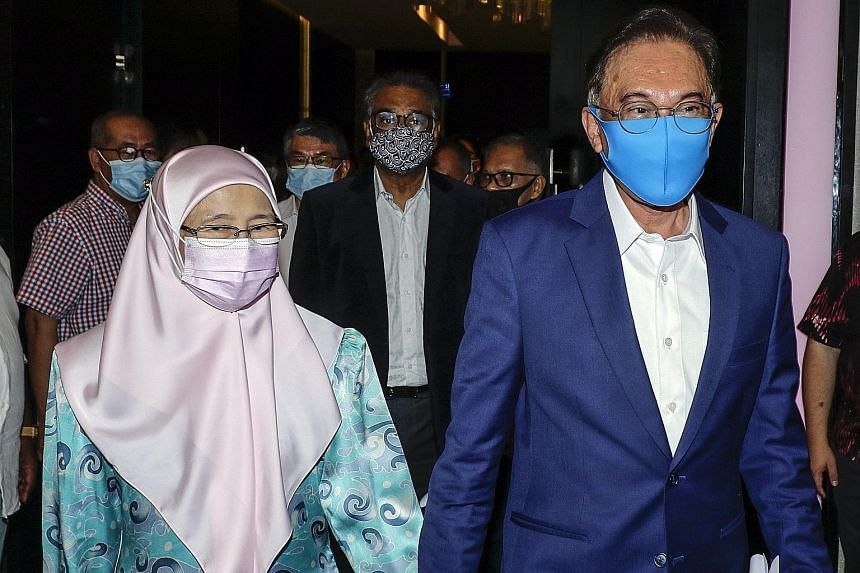 Opposition leader Anwar Ibrahim and his wife Wan Azizah Wan Ismail arriving for a press conference in Kuala Lumpur on Wednesday.