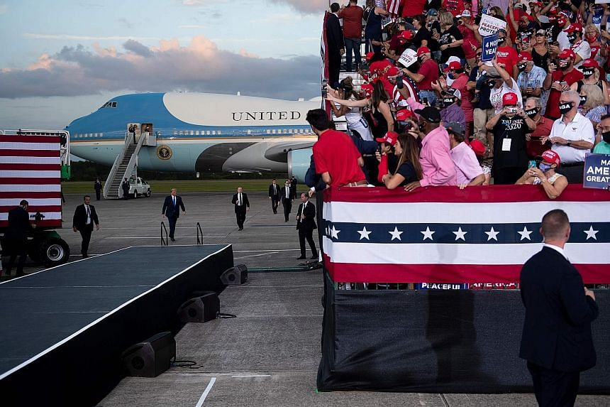 "President Donald Trump arriving to speak at a campaign rally at Cecil Airport in Jacksonville, Florida, on Thursday. He said he did not know that an ""honest"" election could be held on Nov 3 ""with this whole situation, unsolicited ballots""."